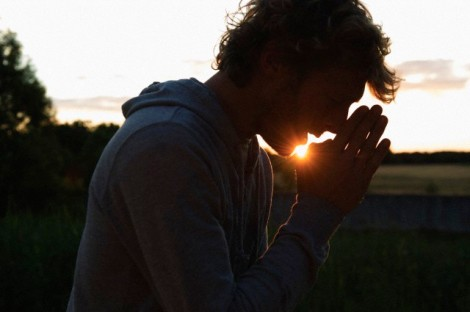 Silhouette of man praying at sunset --- Image by © Benedicte Vanderreydt/cultura/Corbis
