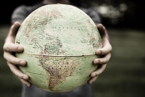 woman-holding-a-globe